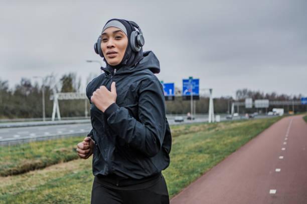 Beautiful Female Athlete wearing a sports hijab stock photo