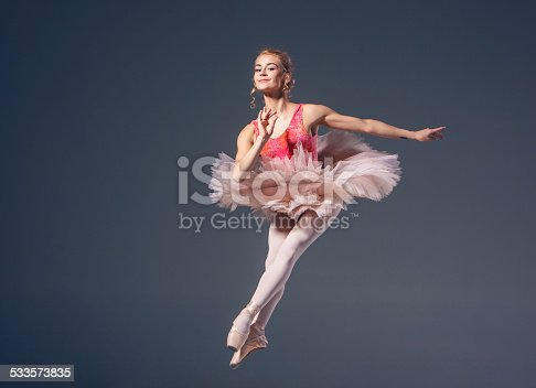 476021886 istock photo Beautiful female ballet dancer on a grey background. Ballerina is 533573835