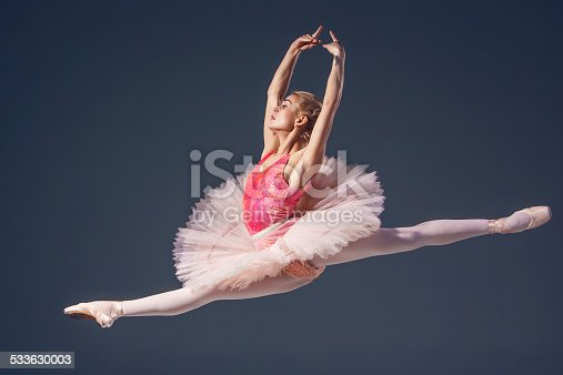 istock Beautiful female ballet dancer on a grey background. Ballerina is 533630003