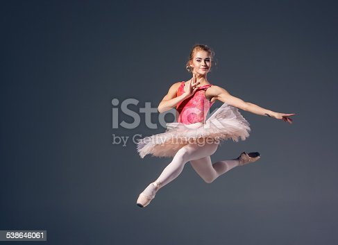 476021886 istock photo Beautiful female ballet dancer on a grey background. Ballerina is 538646061