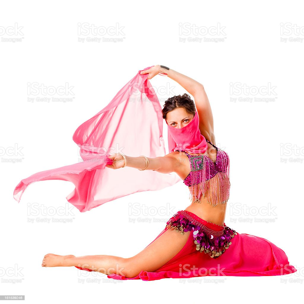 A beautiful female belly dancer in a pink costume stock photo