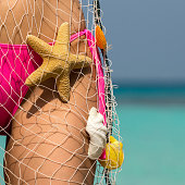 istock Beautiful female body on the beach 473293850