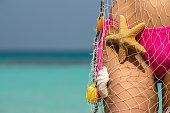 istock Beautiful female body on the beach, 473296650