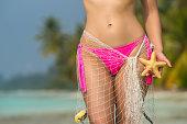 istock Beautiful female body on the beach 485179508