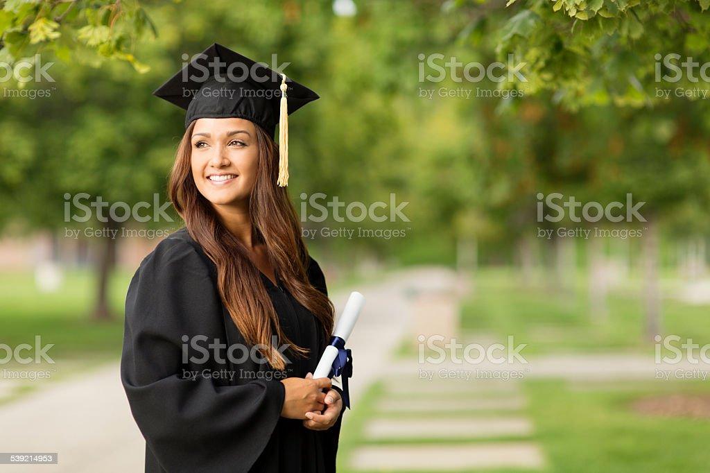 Beautiful Female College Graduate Holding Diploma stock photo