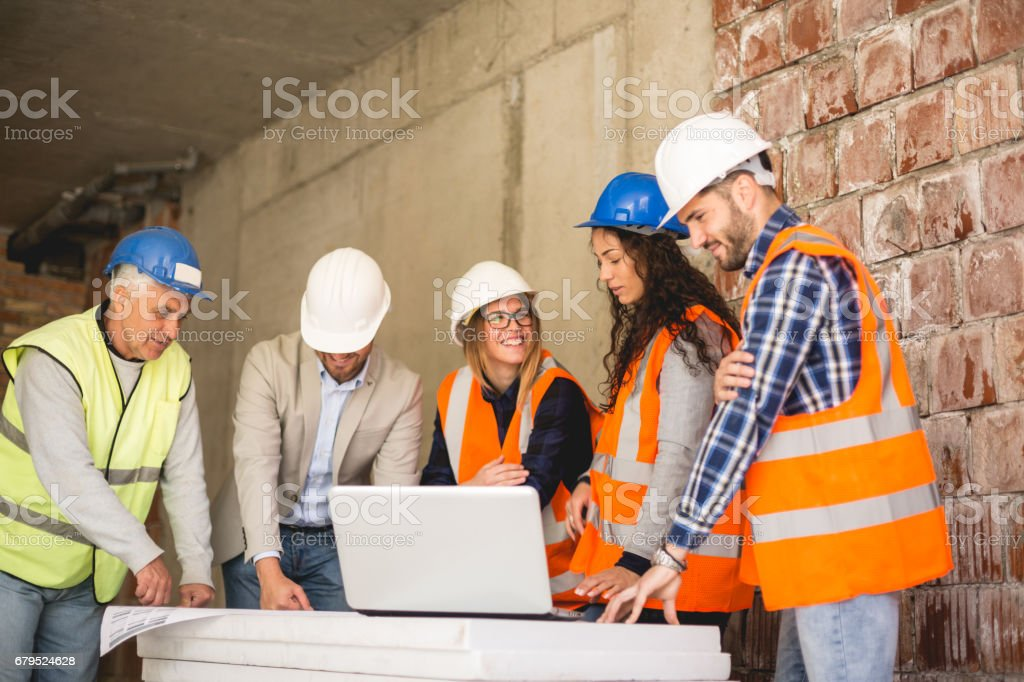 Beautiful female Construction workers talking on site royalty-free stock photo