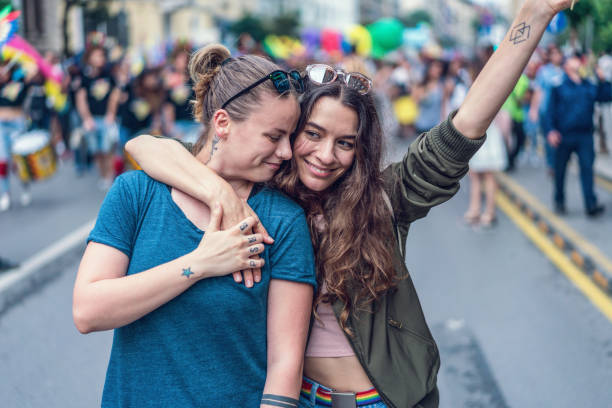 Beautiful female couple at the LGBTQI pride event stock photo