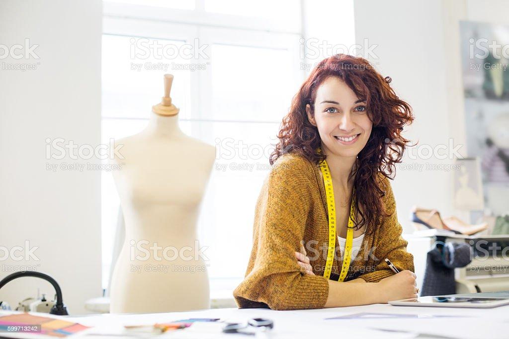 Beautiful female designer at design studio stock photo