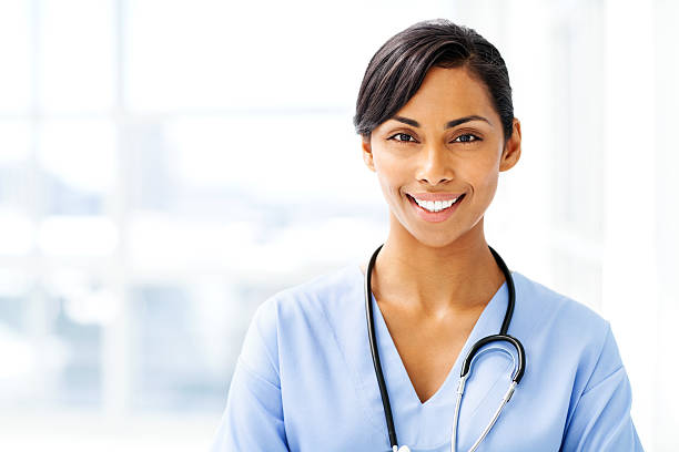 beautiful female doctor smiling - female nurse stock photos and pictures