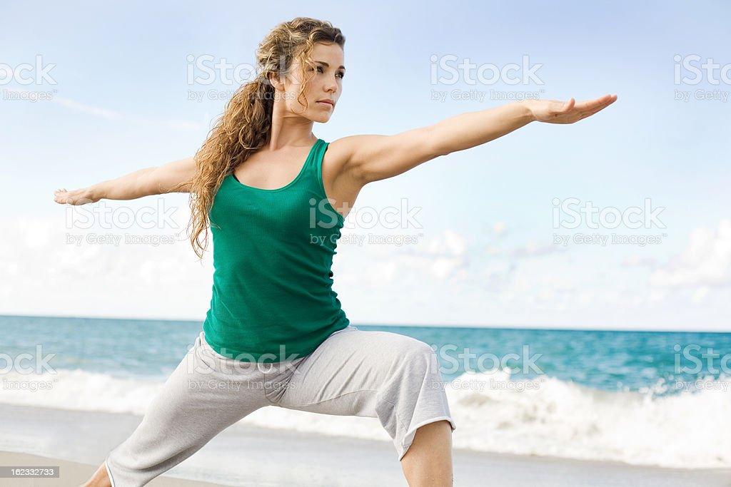 Beautiful female doing yoga warrior pose royalty-free stock photo