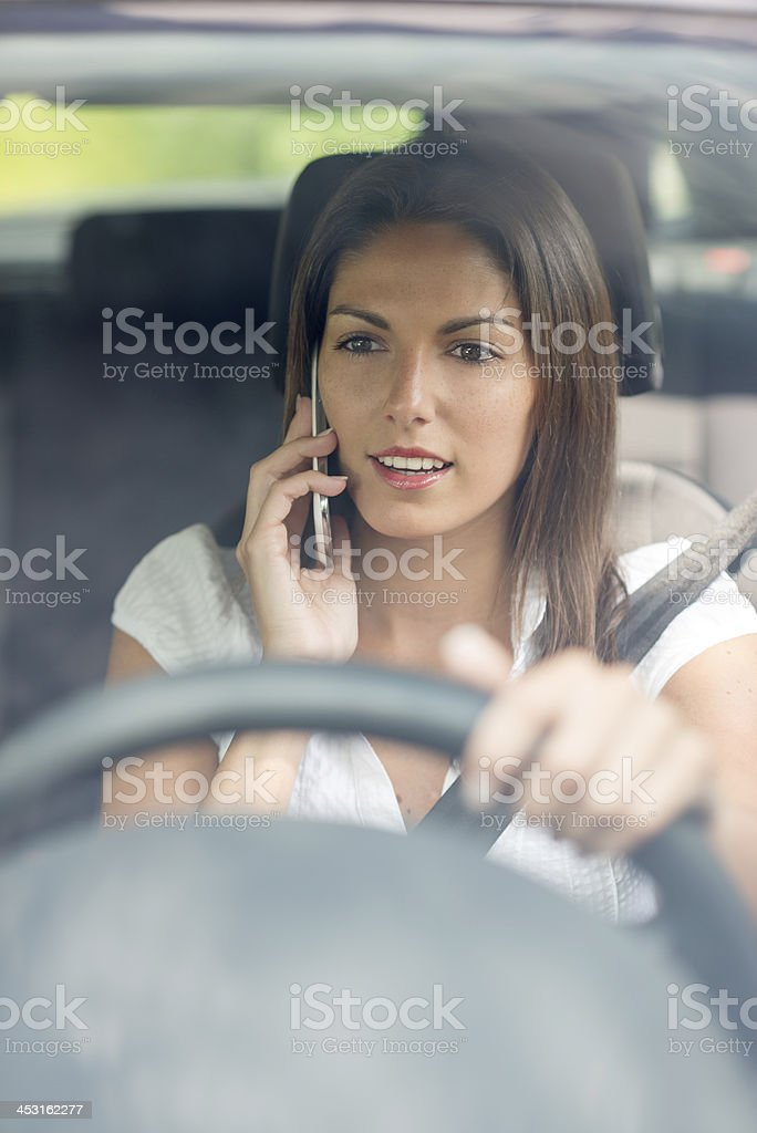 Beautiful female Driver talking on the Phone royalty-free stock photo