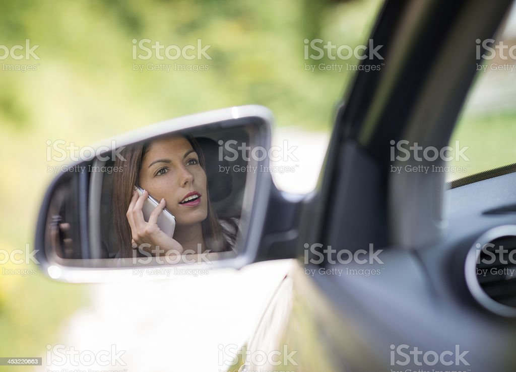 Beautiful female Driver talking on the Phone stock photo