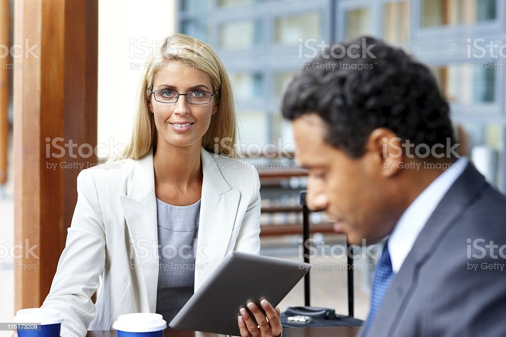 Beautiful female executive working in office royalty-free stock photo
