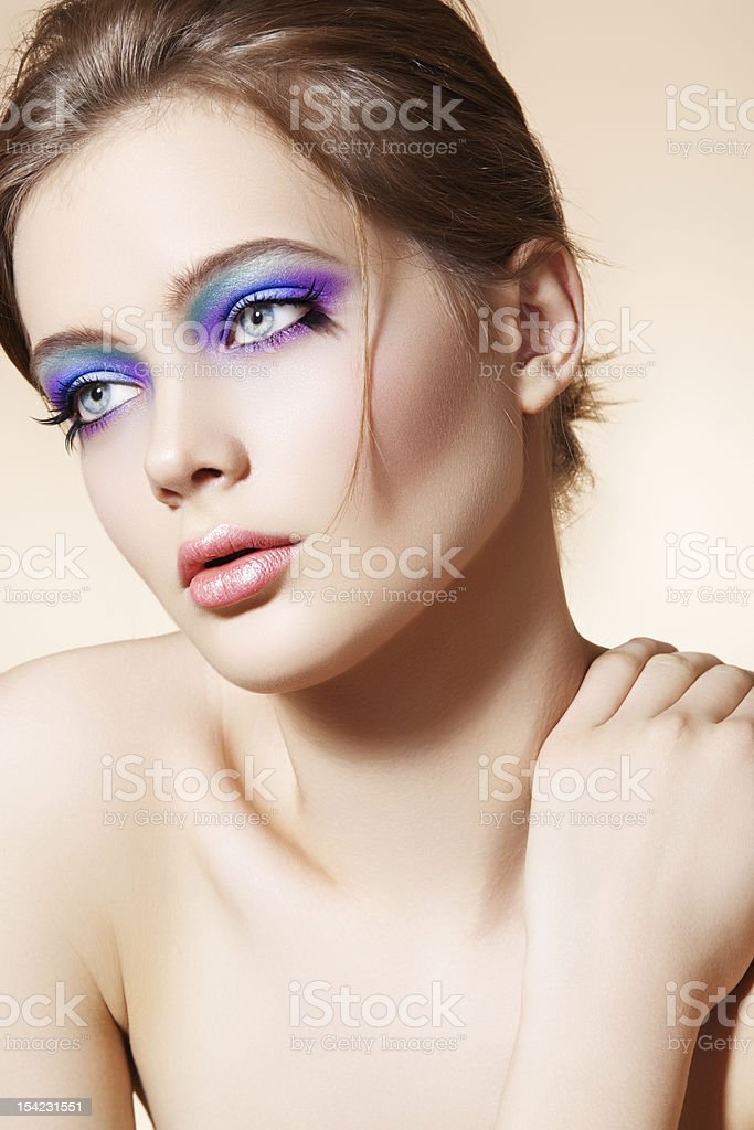 Beautiful female face with bright fashion make-up stock photo