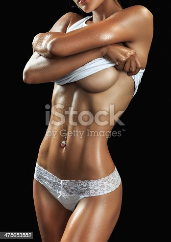 istock Beautiful female fitness model 475653552