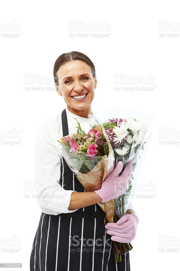 Beautiful  female florist holding bouquet of fresh flowers stock photo