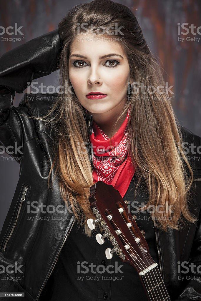 Beautiful female guitarist royalty-free stock photo