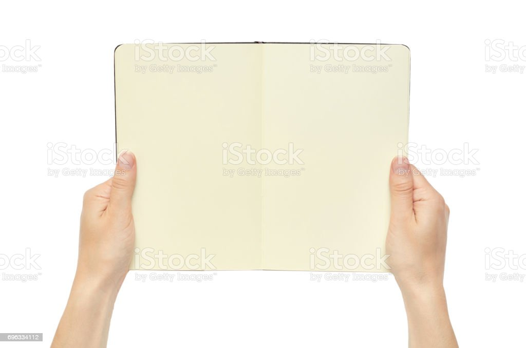 Beautiful female hand holding note book. Isolated on white background stock photo