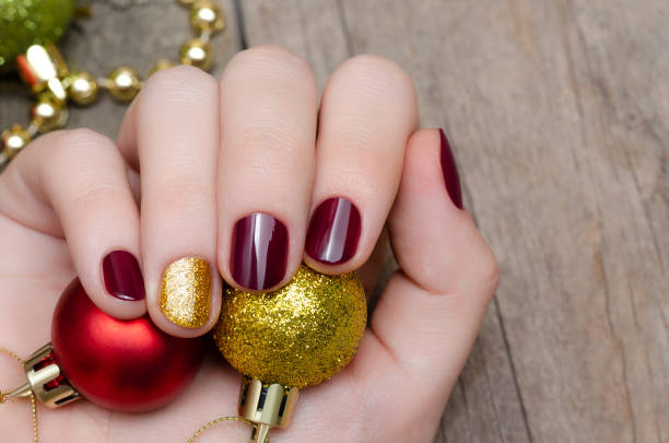 Beautiful female hand with christmas nail design stock photo