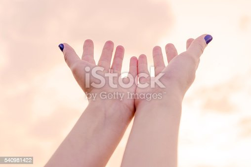 974882202istockphoto beautiful female hands and the sky 540981422