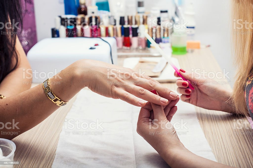 Beautiful female hands with the beauty salon, the client stock photo
