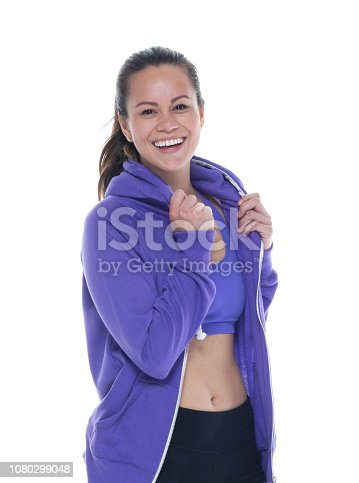 istock Beautiful female in sports clothing standing and being happy 1080299048
