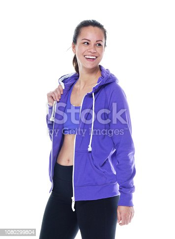 istock Beautiful female in sports clothing standing and being happy 1080299804