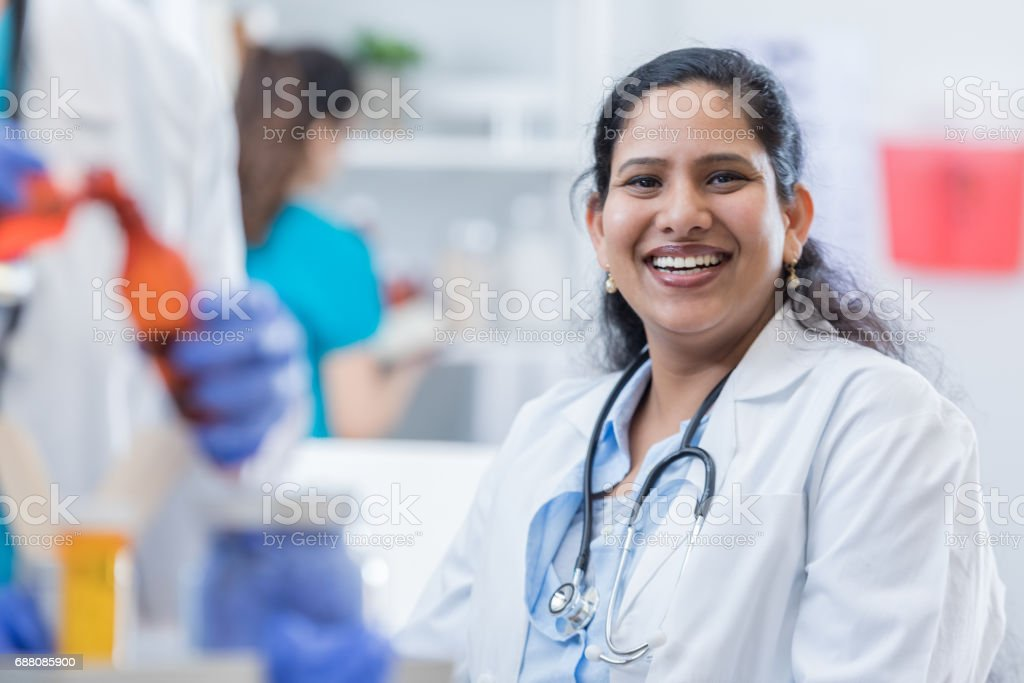 Beautiful female Indian doctor stock photo