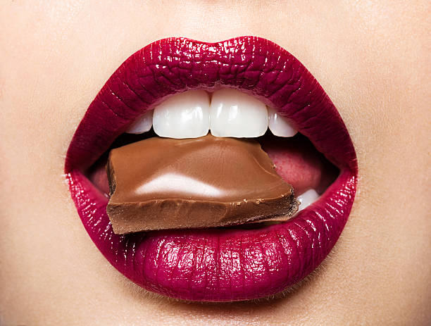 beautiful female lips with chocolate - human lips stock photos and pictures