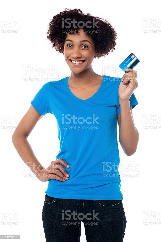 Beautiful female mode hlolding up cash card stock photo