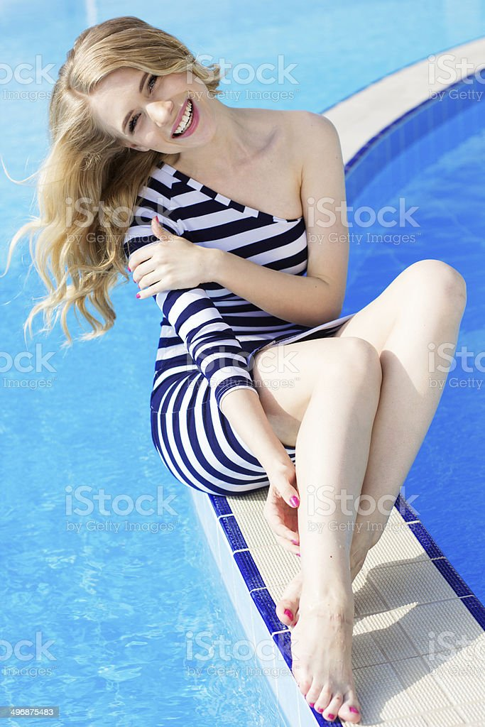 beautiful female model posing by the pool royalty-free stock photo