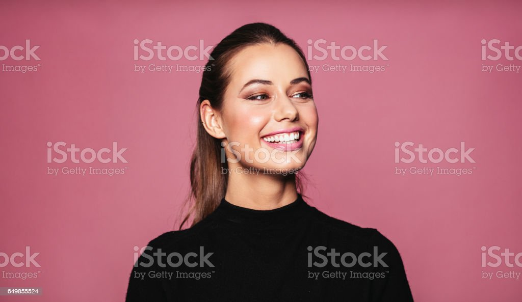 Beautiful female model standing and smiling stock photo