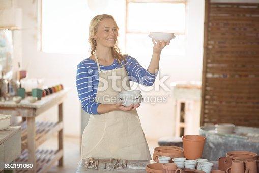istock Beautiful female potter checking bowl 652191060