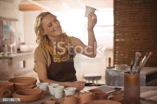 istock Beautiful female potter checking pot 652188776