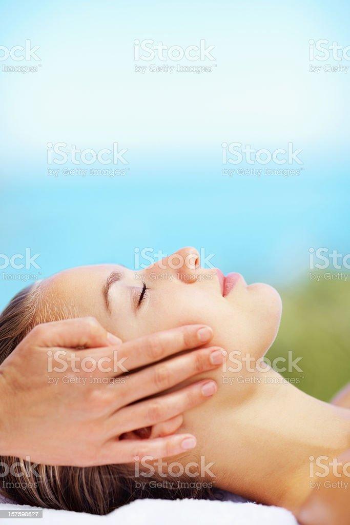 Beautiful female receiving facial massage royalty-free stock photo
