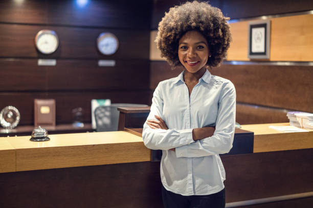 Beautiful female receptionist looking at camera stock photo