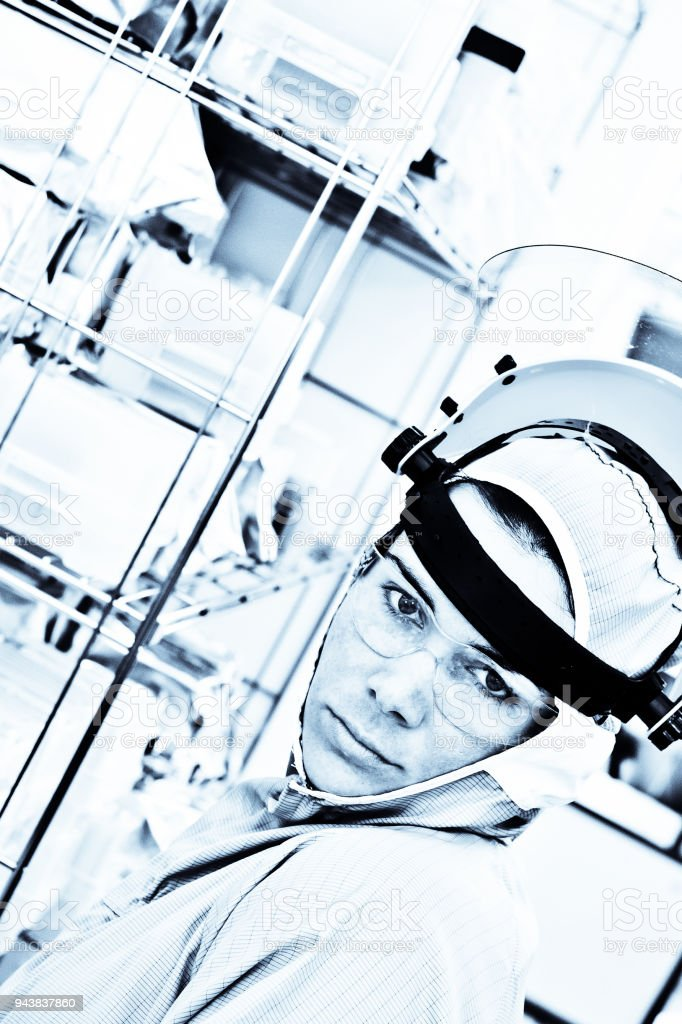 Beautiful Female Research PhD Student Pose In A Cleanroom/Laboratory stock photo