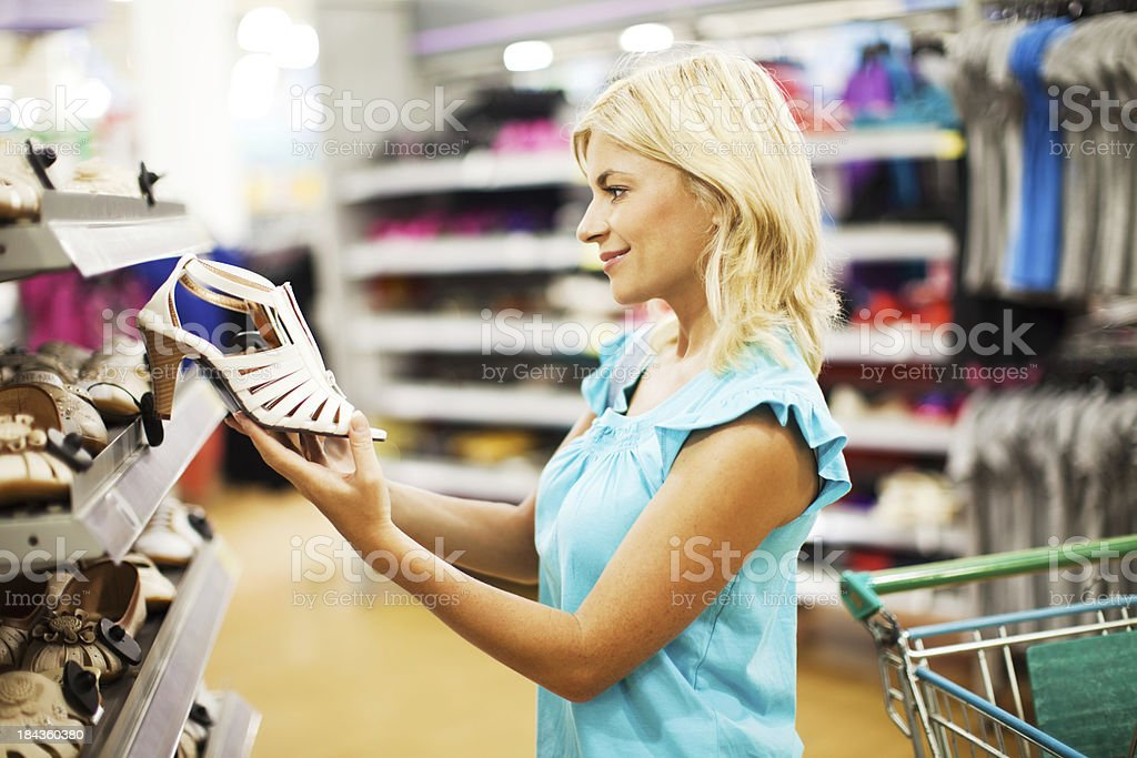 Beautiful female shopping for shoes. royalty-free stock photo
