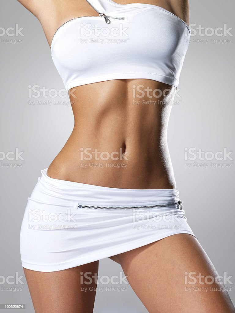 Beautiful female slim tanned body stock photo