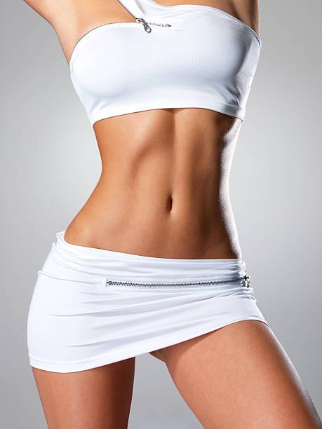 Beautiful female slim tanned body stock photo