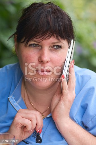 istock Beautiful female speaking on mobile phone.Girl with phone making a call 876321602