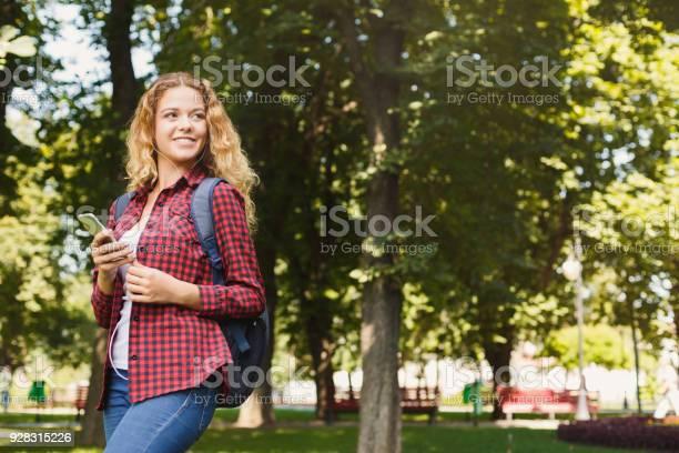 Beautiful female student using mobile smartphone outdoors picture id928315226?b=1&k=6&m=928315226&s=612x612&h= bhgsa v1oqyn1zeifanlzl1jgkdkllrahxvxwl1zsq=