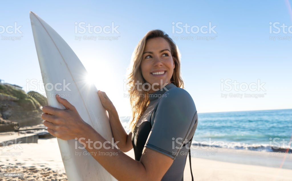 Beautiful female surfer at the beach - Royalty-free Adult Stock Photo