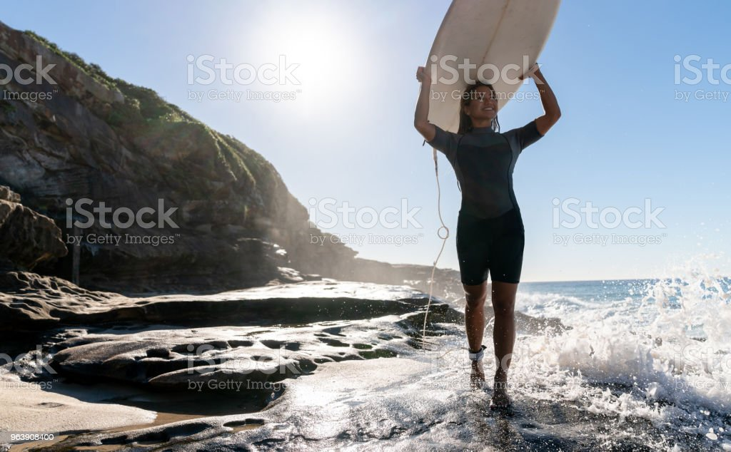 Beautiful female surfer carrying her board - Royalty-free Adult Stock Photo
