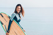 Beautiful female surfer, with copy space