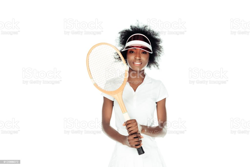 beautiful female tennis player in cap with racket isolated on white stock photo