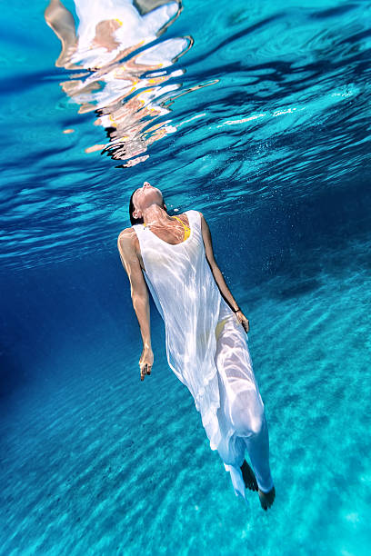 Beautiful female underwater stock photo