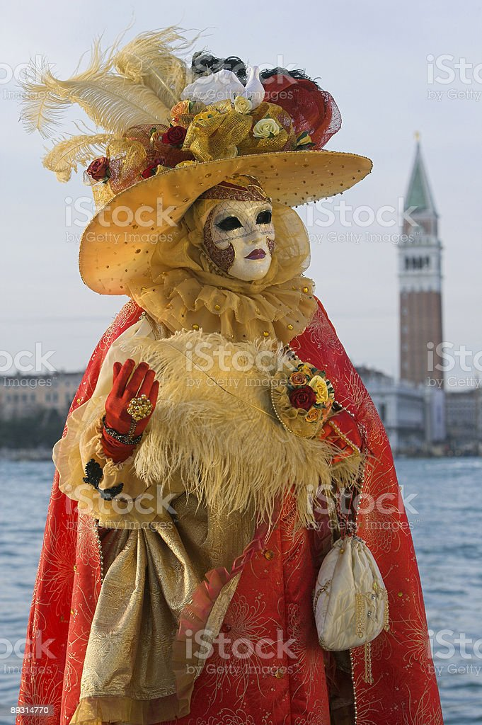 Beautiful female venetian mask at carnival in Venice royalty-free stock photo