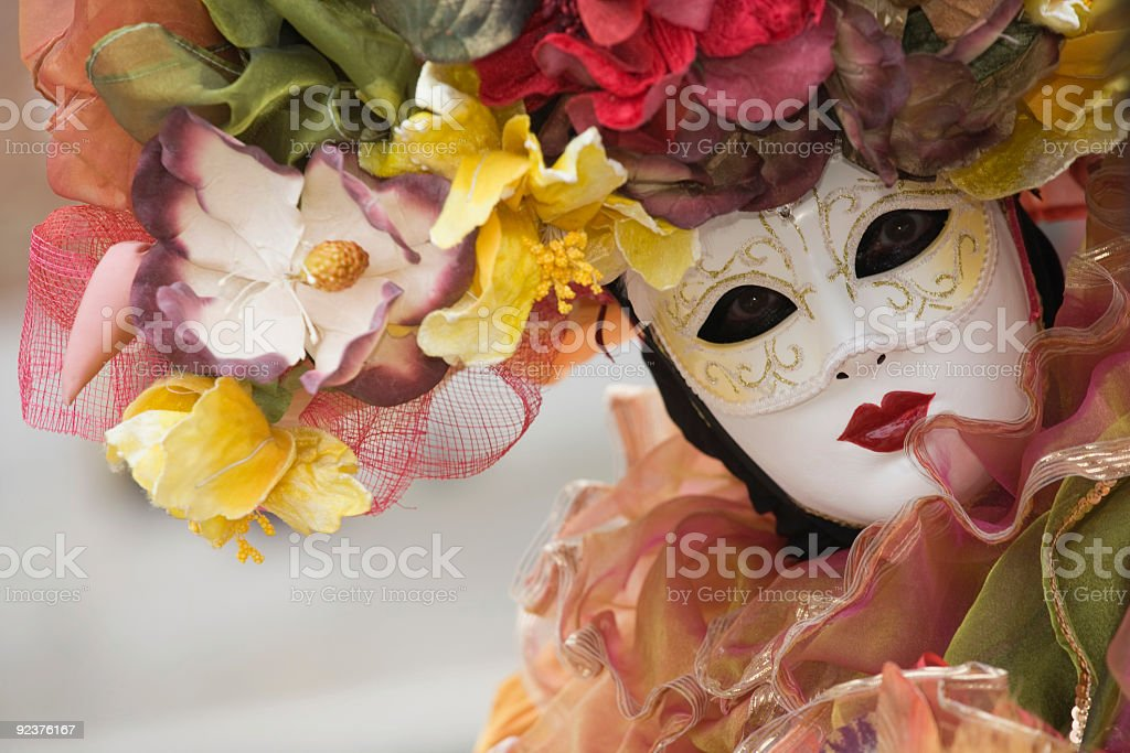 Beautiful female venetian mask at carnival in Venice stock photo