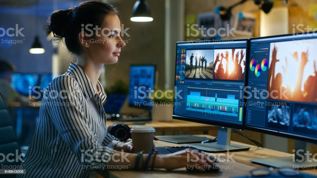 Beautiful Female Video Editor Works with Footage on Her Personal Computer, She Works in Creative Office Studio. stock photo